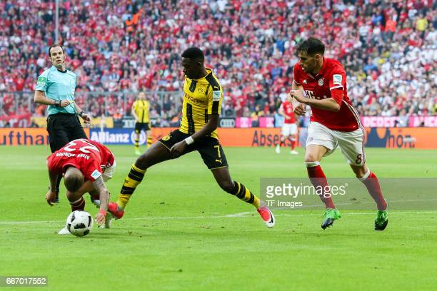 Arturo Erasmo Vidal of Munich Javier Martinez of Munich and Ousmane Dembele of Dortmund battle for the ball during the Bundesliga match between...