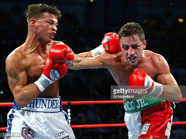 Arturo Gatti and Gianluca Branco exchange punches during their 12 round fight for the vacant WBC Junior Welterweight Championship Gatti captured the...