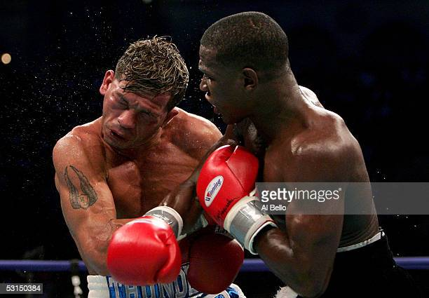Arturo Gatti is hit by Floyd Mayweather Jr during their WBC Super Lightweight Championship fight at Boardwalk Hall on June 25 2005 in Atlantic City...