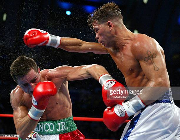Arturo Gatti lands a right hand to the head of Gianluca Branco during their 12 round fight for the vacant WBC Junior Welterweight Championship Gatti...