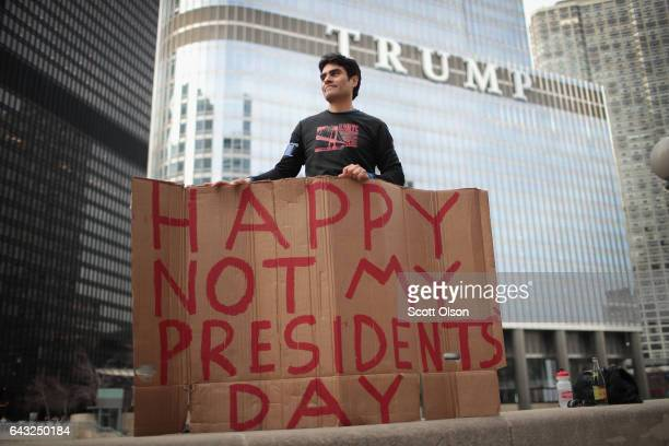 Arturo Gomez participates in a Presidents Day protest near Trump Tower on February 20, 2017 in Chicago, Illinois. The demonstration was one of many...