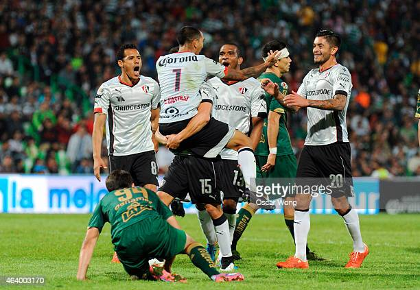 Arturo Gonzalez celebrates with teammates after scoring the winning goal during a match between Santos Laguna and Atlas as part of 7th round Clausura...