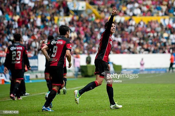 Arturo Gonzalez of Atlas celebrates a goal during a match between Atlas and Puebla as part of the Apertura 2012 Liga MX at Jalisco Stadium on...