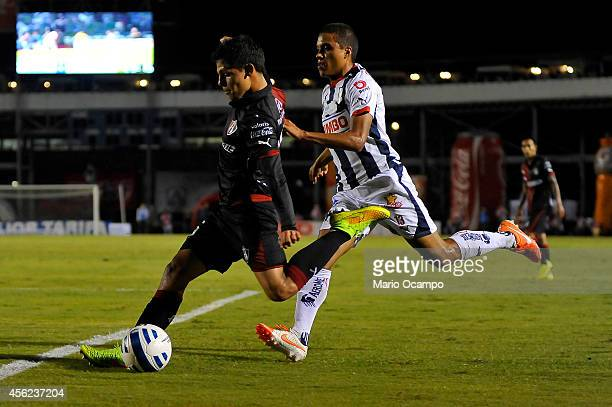 Arturo Gonzalez of Atlas fights for the ball with Alonso Hernandez of Monterrey during a match between Monterrey and Atlas as part of 10th round...