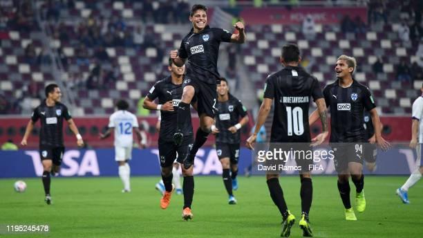 Arturo Gonzalez of CF Monterrey celebrates with teammates Jonathan Urretaviscaya and William Meija of CF Monterrey after scoring his team's first...