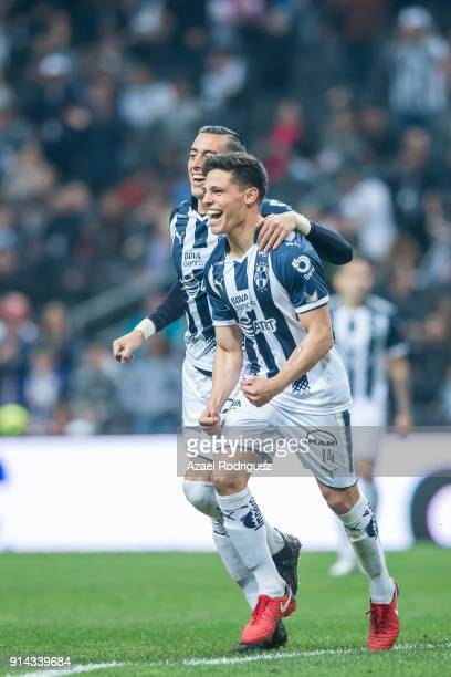 Arturo Gonzalez of Monterrey celebrates with teammate Rogelio Funes Mori after scoring his team's third goal during the 5th round match between...