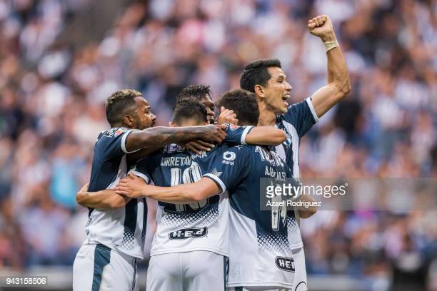 Arturo Gonzalez of Monterrey celebrates with teammates after scoring his team's first goal via penalty during the 14th round match between Monterrey...
