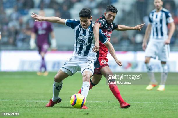 Arturo Gonzalez of Monterrey fights for the ball with Jose Rivero of Tijuana during the third round match between Monterrey and Tijuana as part of...