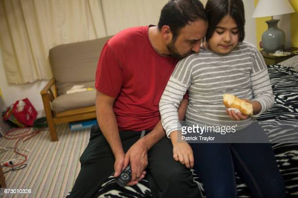 Arturo Hernandez Garcia shares a moment with his youngest daughter Andrea during a visit by his family on Feb 20 2015 While his family continues to...