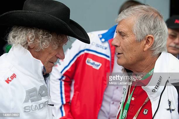 Arturo Merzario of Italy and Giacomo Agostini of Italy look on in pit during qualifying session of the Superbike World Championship Round Four at...