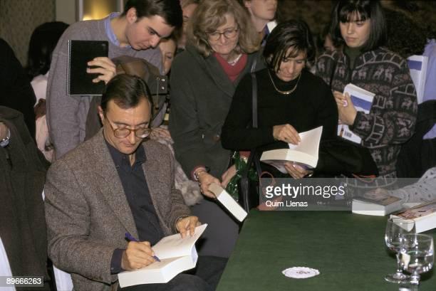 Arturo Perez Reverte presents his book ´La piel del tambor´ The writer signing copies of his book