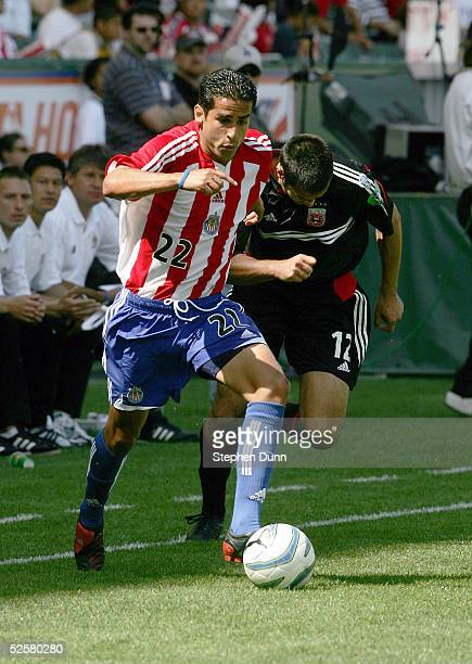 Arturo Torres of Chivas USA controls the ball in front of Mike Petke of DC United in their Major League Soccer match on April 2 2005 at the Home...