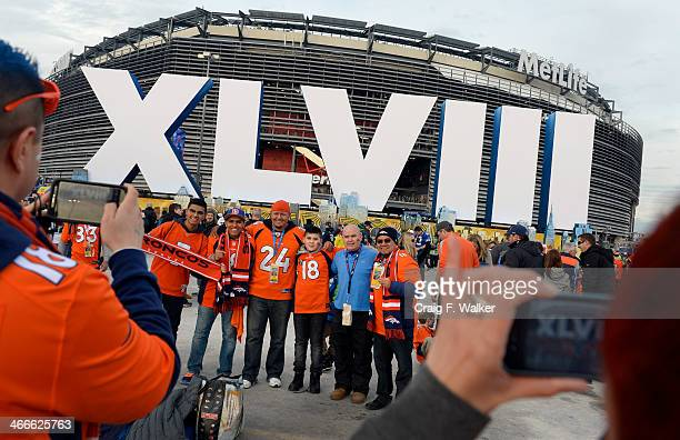 Arturo Vargas and his family and friends all from Aurora Colorado have their photo taken outside of the stadium prior to the game The Denver Broncos...