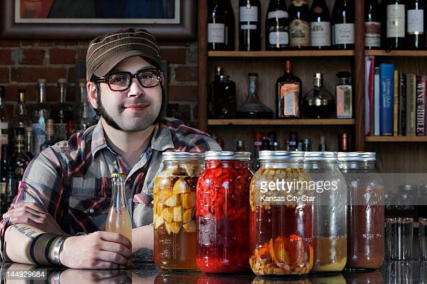 Arturo VeraFelicie bar manager at The Farmhouse in Kansas City Missouri displays some of the homemade shrubs he creates using fresh local produce He...