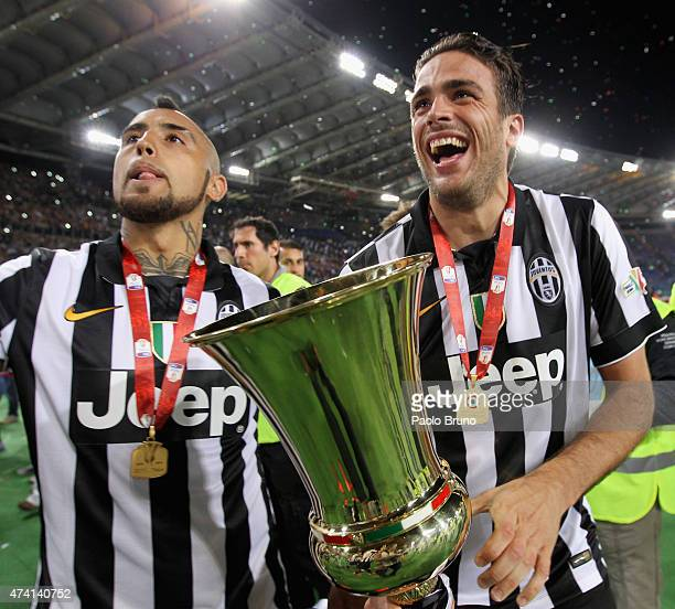 Arturo Vidal and Alessandro Matri of Juventus FC celebrate with the trophy after winning the TIM Cup final match against SS Lazio at Olimpico Stadium...