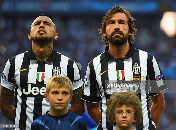 Arturo Vidal and Andrea Pirlo of Juventus line up prior to the UEFA Champions League Final between Juventus and FC Barcelona at Olympiastadion on...