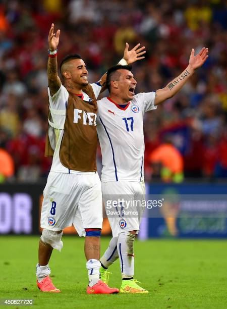 Arturo Vidal and Gary Medel of Chile celebrate after defeating Spain 20 during the 2014 FIFA World Cup Brazil Group B match between Spain and Chile...