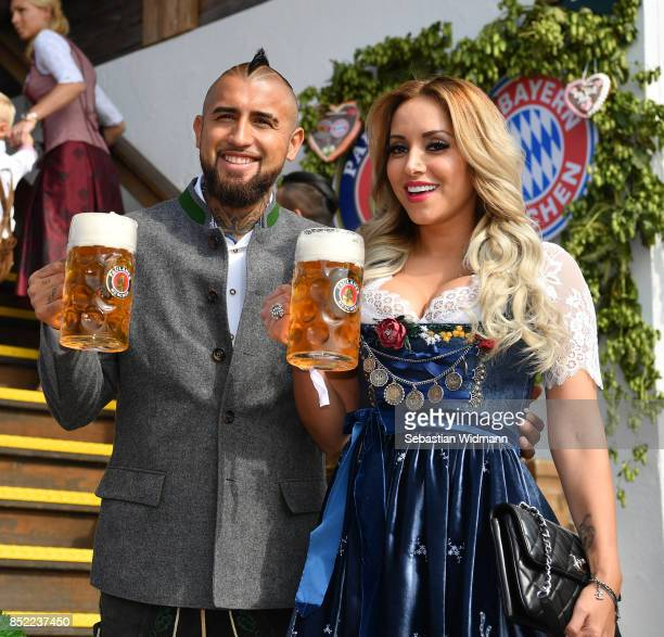 Arturo Vidal and his wife Maria Teresa Matus atttend the Oktoberfest beer festival at Kaefer Wiesnschaenke tent at Theresienwiese on September 23...