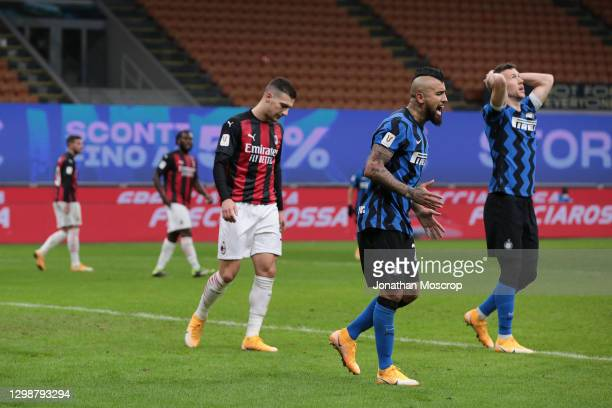 Arturo Vidal and Ivan Perisic of Internazionale react after a chance goes beggin as Diogo Dalot of AC Milan stares at the ground during the Coppa...