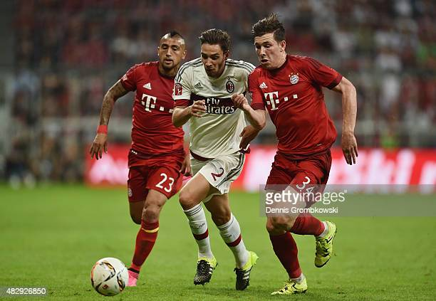 Arturo Vidal and PierreEmile Hojbjerg of FC Bayern Muenchen chase Mattia De Sciglio of AC Milan during the Audi Cup 2015 match between FC Bayern...