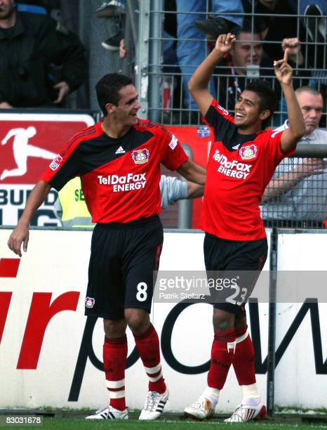 Arturo Vidal and Renato Augusto of Leverkusen celebrate after the 0-1 during the Bundesliga match between VfL Bochum and Bayer Leverkusen at the...