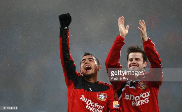 Arturo Vidal and Tranquillo Barnetta of Leverkusen celebrate their 0:3 win at the Bundesliga match between 1899 Hoffenheim and Bayer Leverkusen at...