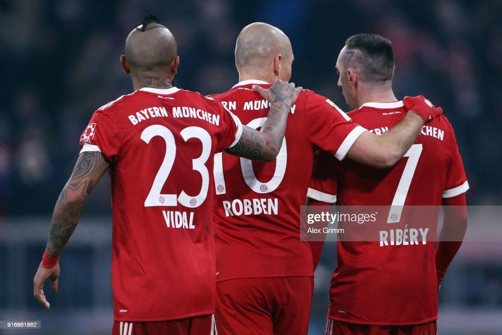 Arturo Vidal, Arjen Robben and Franck Ribery (L-R) of Muenchen react during the Bundesliga match between FC Bayern Muenchen and FC Schalke 04 at Allianz Arena on February 10, 2018 in Munich, Germany.