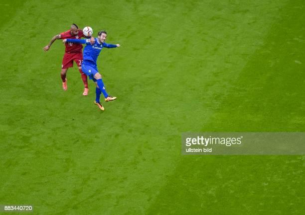 Arturo Vidal im Kopfballduell mit Mario Vrancic waehrend dem Fussball Bundesliga Spiel FC Bayern Muenchen gegen SV Darmstadt 98 am 22 Spieltag der...