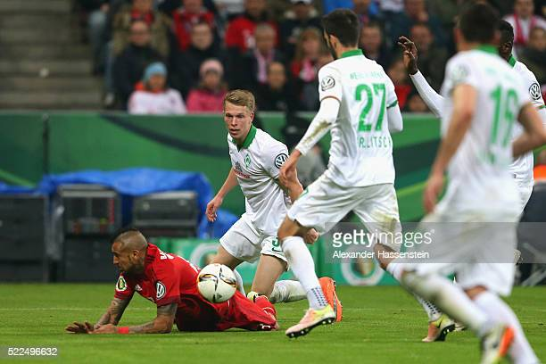 Arturo Vidal is challenged by Janek Sternberg of Bremen in the penalty box during the DFB Cup semi final match between FC Bayern Muenchen and Werder...