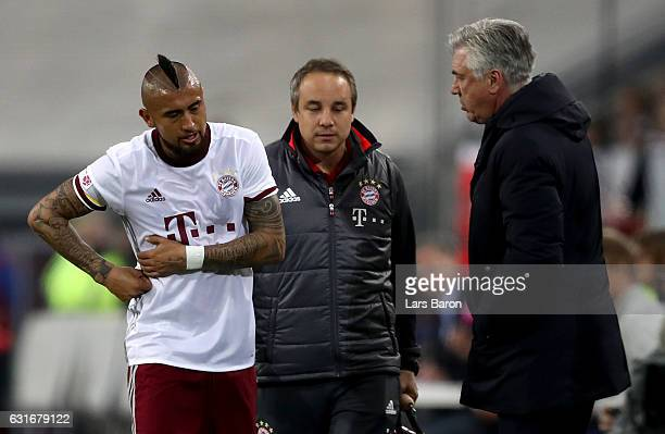 Arturo Vidal leaves injured the pitch next to head coach Carlo Ancelotti during the Telekom Cup 2017 final between Bayern Muenchen and FSV Mainz 05...