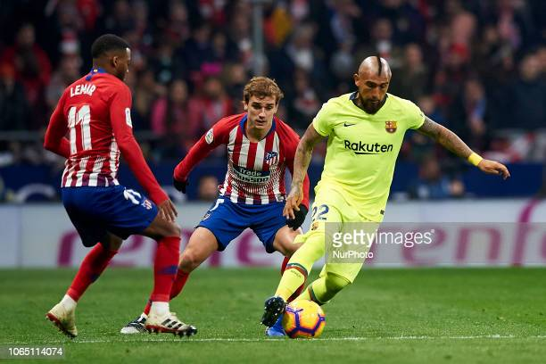 Arturo Vidal of Barcelona and Antoine Griezmann of Atletico Madrid battle for the ball during the week 13 of La Liga match between Atletico Madrid...