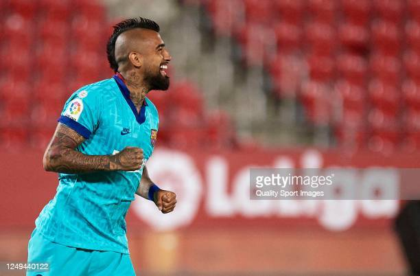 Arturo Vidal of Barcelona celebrates after scoring his team's first goal during the Liga match between RCD Mallorca and FC Barcelona at Iberostar...