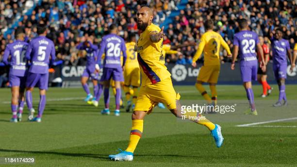 Arturo Vidal of Barcelona celebrates his goal with team mates during the Liga match between CD Leganes and FC Barcelona at Estadio Municipal de...
