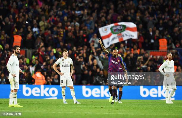 Arturo Vidal of Barcelona celebrates scoring his sides fifth goal as Real Madrid players look dejected during the La Liga match between FC Barcelona...