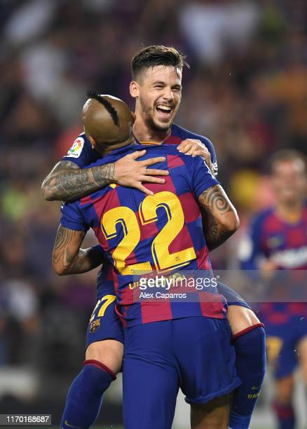 Arturo Vidal of Barcelona celebrates with teammate Carles Perez after scoring his team's fifth goal during the Liga match between FC Barcelona and...
