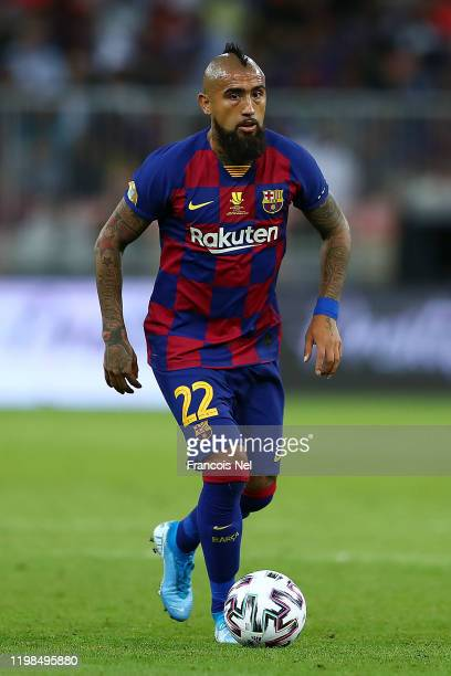 Arturo Vidal of Barcelona in action during the Supercopa de Espana SemiFinal match between FC Barcelona and Club Atletico de Madrid at King Abdullah...