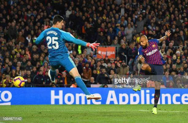 Arturo Vidal of Barcelona scores his sides fifth goal past Thibaut Courtois of Real Madrid during the La Liga match between FC Barcelona and Real...