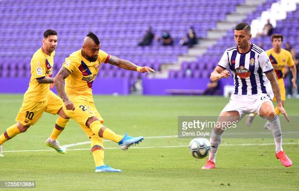 Arturo Vidal of Barcelona scores his team's first goal during the Liga match between Real Valladolid CF and FC Barcelona at Jose Zorrilla on July 11,...
