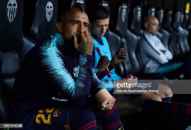 Arturo Vidal of Barcelona sits on the bench prior to the the La Liga match between Valencia CF and FC Barcelona at Estadio Mestalla on October 7 2018...