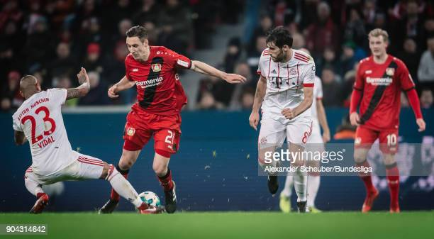 Arturo Vidal of Bayern in action against Dominik Kohr of Leverkusen during the Bundesliga match between Bayer 04 Leverkusen and FC Bayern Muenchen at...