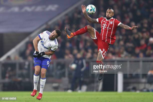 Arturo Vidal of Bayern Muenchen and Franco Di Santo of Schalke fight for the ball during the Bundesliga match between FC Bayern Muenchen and FC...