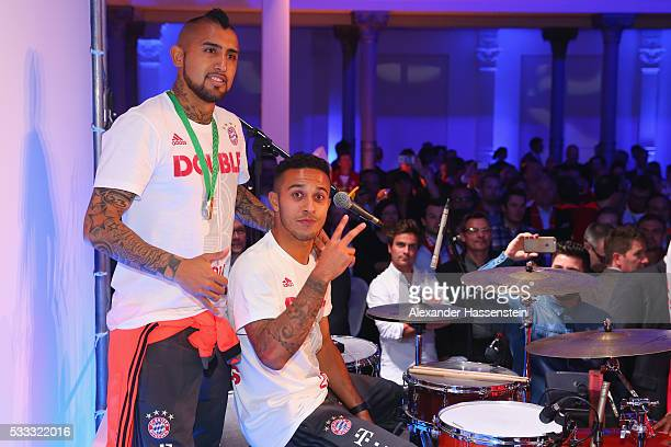 Arturo Vidal of Bayern Muenchen and his team mate Thiago performe during the FC Bayern Muenchen champions party at Deutsche Telekom's representative...