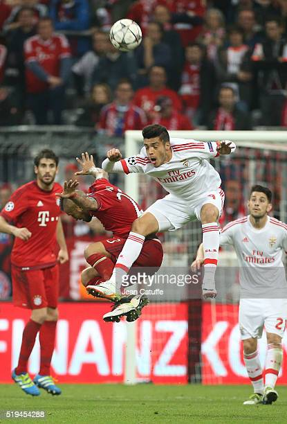 Arturo Vidal of Bayern Muenchen and Raul Jimenez of Benfica in action during the UEFA Champions League quarter final first leg match between FC...