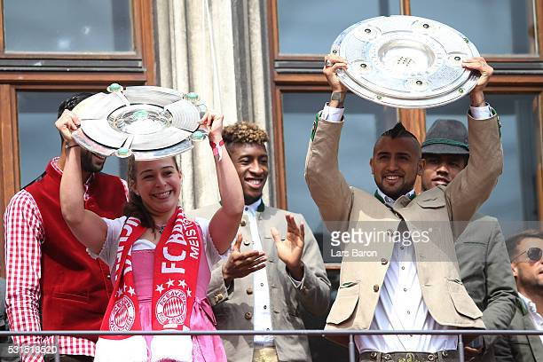 Arturo Vidal of Bayern Muenchen and Sarah Romert of Women's team lift Meisterschale as Bayern Muenchen celebrate winning the Bundesliga at...