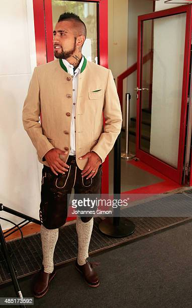 Arturo Vidal of Bayern Muenchen attends the FC Bayern Muenchen Paulaner photo shoot wearing traditional Bavarian dress at Bayern Muenchen's...