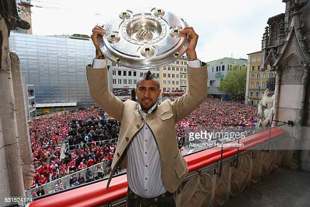 Arturo Vidal of Bayern Muenchen celebrate winning the German Championship title on the town hall balcony at Marienplatz on May 15 2016 in Munich...