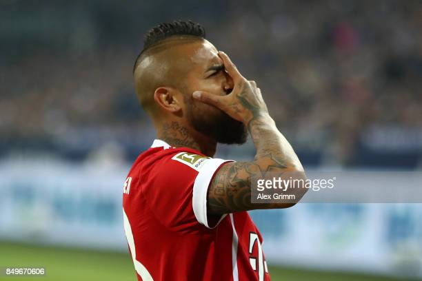 Arturo Vidal of Bayern Muenchen celebrates after he scored his teams third goal to make it 30 during the Bundesliga match between FC Schalke 04 and...