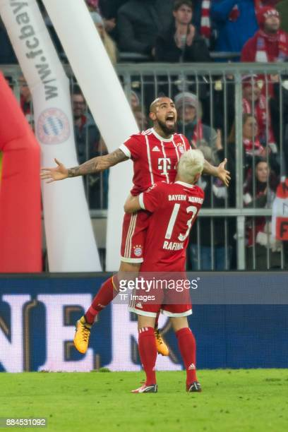 Arturo Vidal of Bayern Muenchen celebrates after scoring his team`s first goal with Rafinha of Bayern Muenchen during the Bundesliga match between FC...