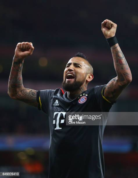 Arturo Vidal of Bayern Muenchen celebrates as he scores their fifth goal during the UEFA Champions League Round of 16 second leg match between...