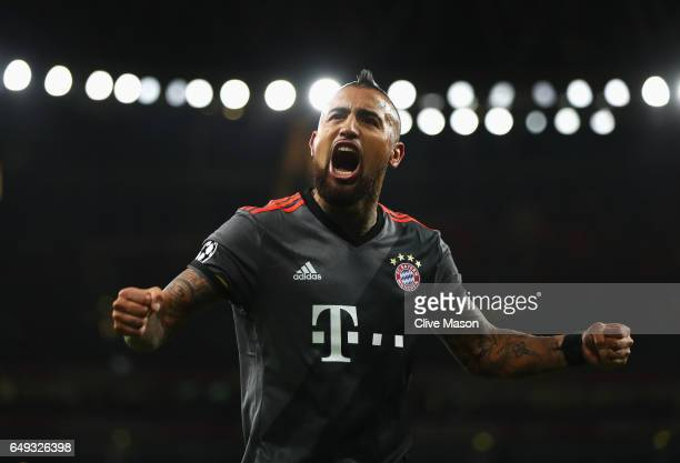 Arturo Vidal of Bayern Muenchen celebrates as he scores their fourth goal during the UEFA Champions League Round of 16 second leg match between...